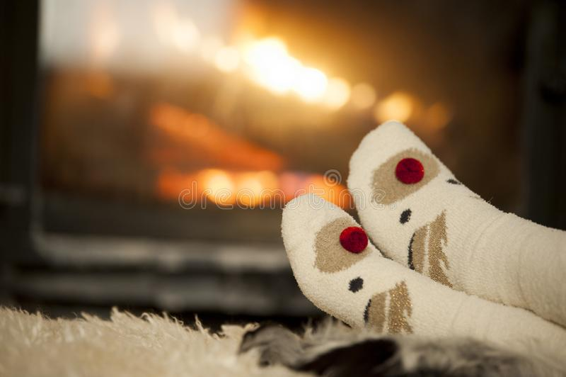 Women`s legs. In front of a chimney stock photography