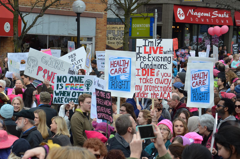 Women`s March Ann Arbor 2017. ANN ARBOR, MI - JAN 21: Protesters rally before the Women's March in Ann Arbor on January 21, 2017 royalty free stock photography