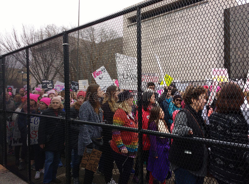 Women`s March Crowd Marching Behind Fences, Washington, DC, USA stock images