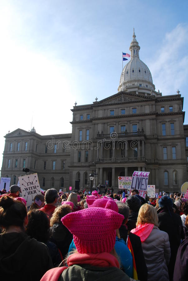 Women`s March on Lansing, Michigan. Millions rallied around the world and nearly ten thousand before the Michigan state capitol in Lansing, Michigan alone, to royalty free stock photo