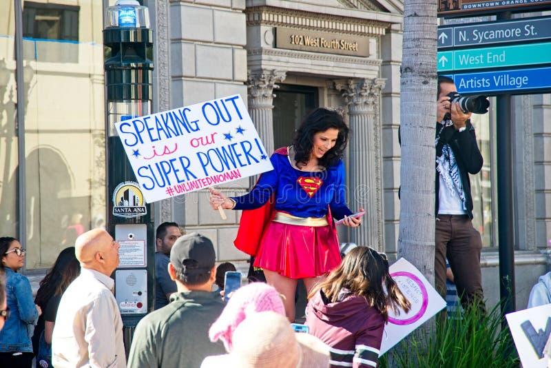 2018 Women`s March in Santa Ana. Santa Ana, California - January 20, 2018: Woman dressed as Super Girl at the 2018 Women`s March in Santa Ana. In hundreds of stock photo