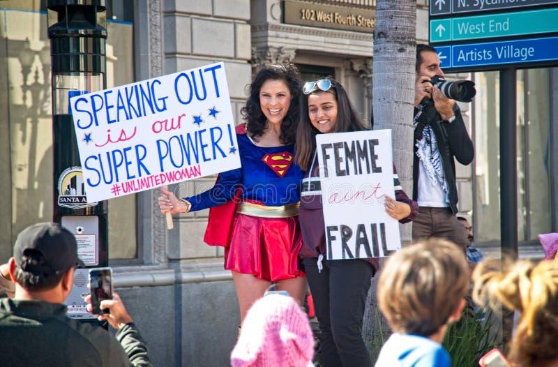2018 Women`s March in Santa Ana. Santa Ana, California - January 20, 2018: Woman dressed as Super Girl at the 2018 Women`s March in Santa Ana. In hundreds of stock image