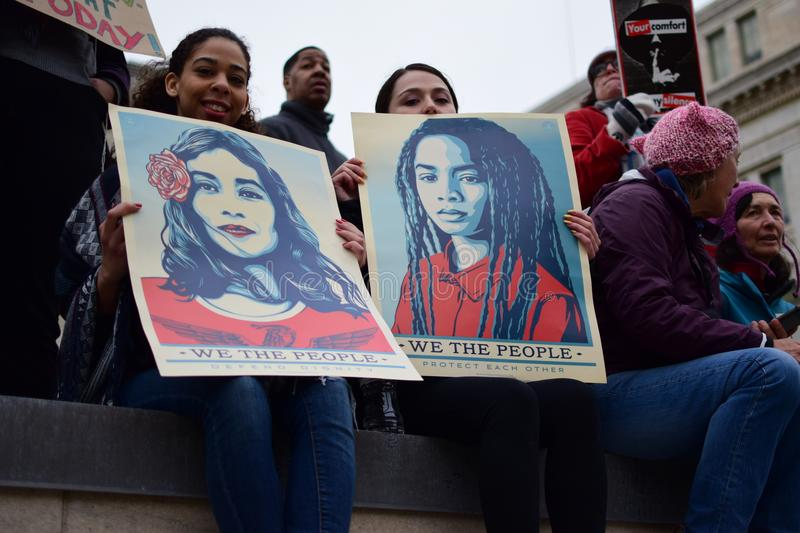Women`s March 2017: We the People Women Edition. Women`s March in Washington DC: We the People posters with Hispanic and African American women royalty free stock photos