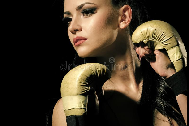 Women`s martial arts. Coach and health. Power and energy. Sport and success. Workout of girl boxer on black background. Woman in boxing gloves and sportswear royalty free stock photos