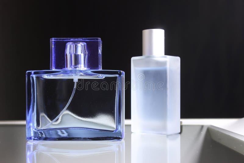 Women`s and men` fragrance stock image