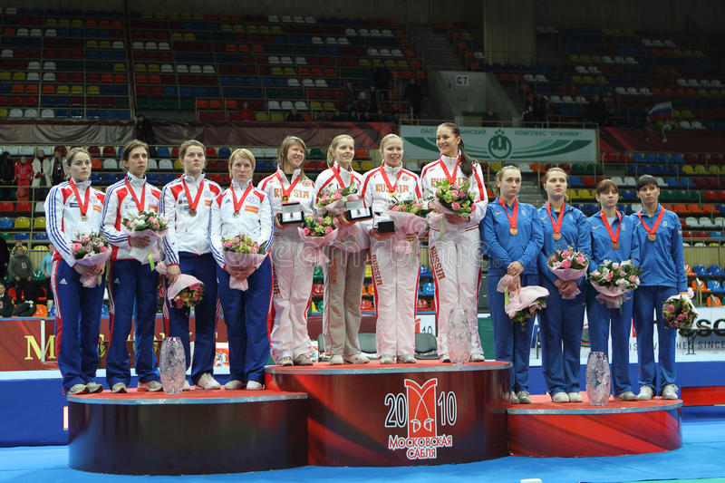 Women's national teams of Rus, Fr and Ukr. Women's national teams of Russia, France and Ukraine finalists at the 2010 RFF Moscow Saber World Fencing Tournament royalty free stock photos