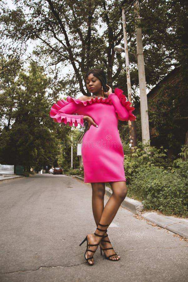 Women's Pink Long-sleeved Off-shoulder Midi Dress royalty free stock image