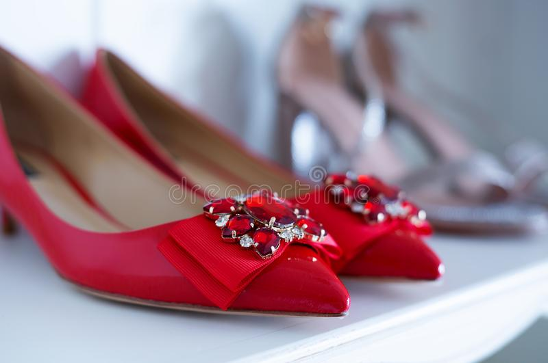 Women`s luxury red shoes on counter shoe store royalty free stock photography