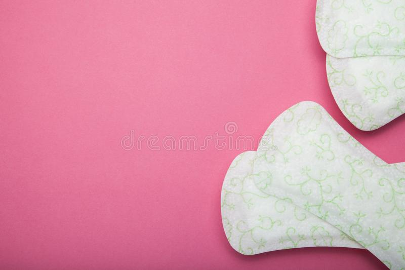 Women`s sanitary pad on pink background. Empty copy space for text stock photos
