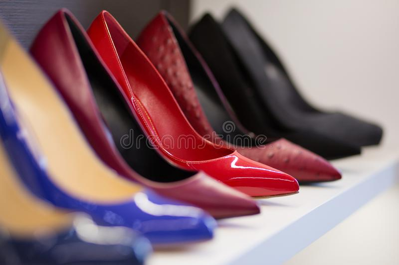 Women& x27;s shoes with heels close up. Women& x27;s shoes on the store shelf stock photography