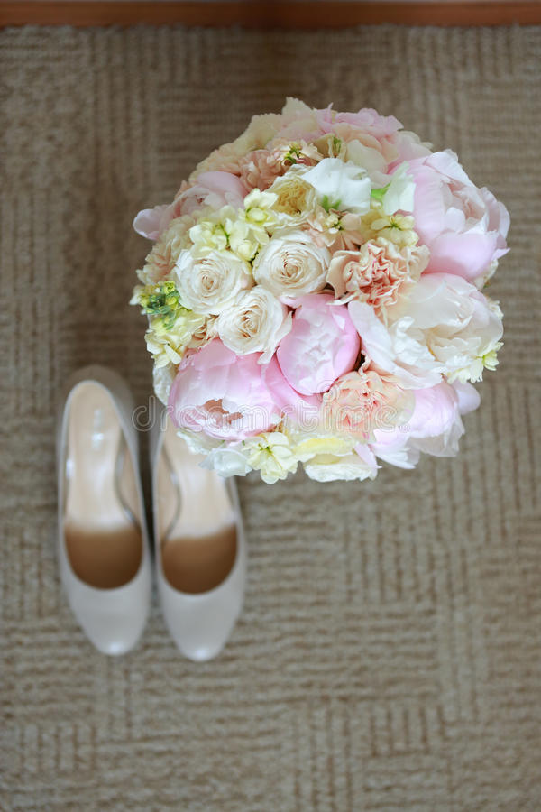 Women's Shoes With Peonies On The Carpet stock photo