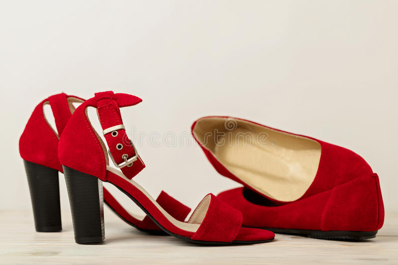 Women`s shoes sandals and ballet flats red color. Selective focus royalty free stock image