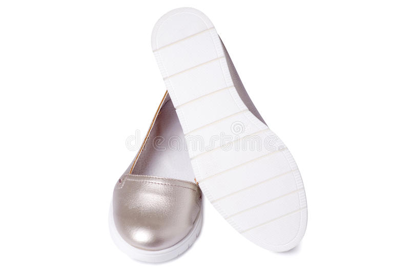 Women`s shoes silver. On the white soles isolated royalty free stock images