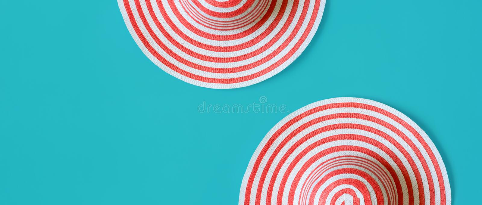 Women`s striped summer romantic Hats On a turquoise background. stock image