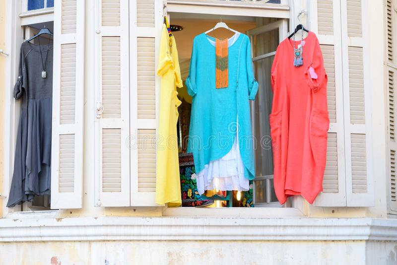 Women`s stylish oriental style ethnic dresses in store at display window, in summer street market. Modern fashion shop or Textile souk , bazaar with colorful stock photo