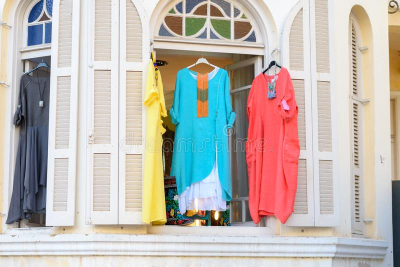 Women`s stylish oriental style ethnic dresses in store at display window, in summer street market. Modern fashion shop or Textile souk , bazaar with colorful royalty free stock image