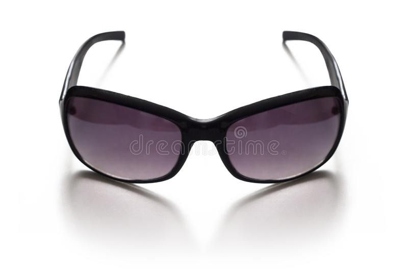 Women`s sunglasses on face with lilac glasses on white royalty free stock photography