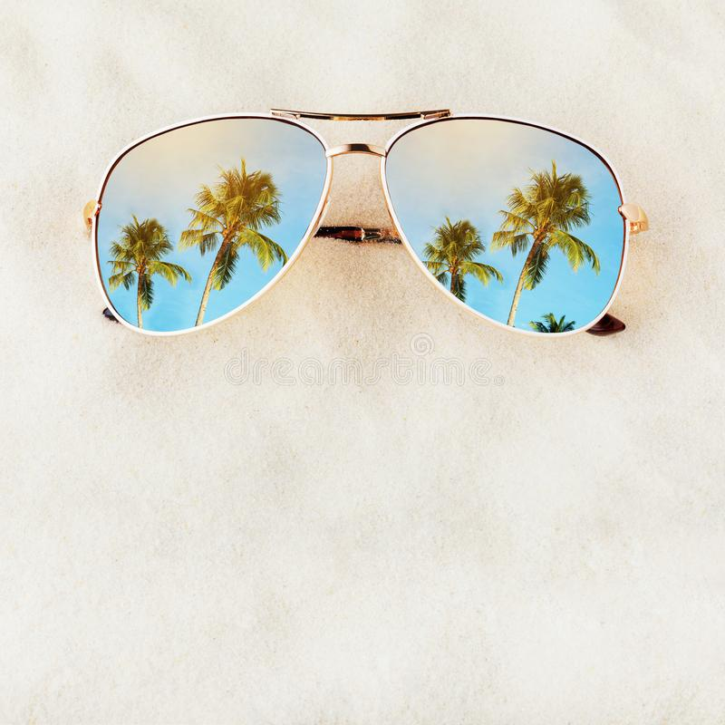 Women`s Sunglasses no title on the sand with space for text royalty free stock photography