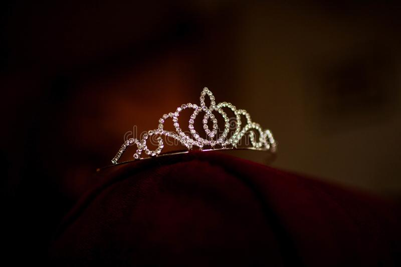 Women`s tiara lying on the table. Women`s tiara of diamonds is on the table stock images