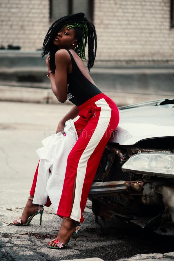 Women's Wearing Black Backless Top With Red and White Pants stock photos