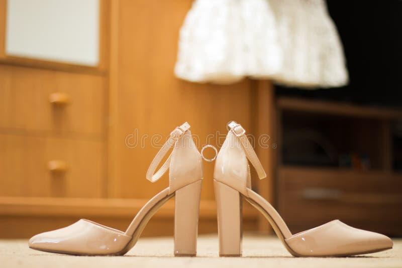 Wedding high heels. Wedding ring, wedding dress  and wedding shoes. Weddingdress, weddingring, weddingshoes, womens royalty free stock photography