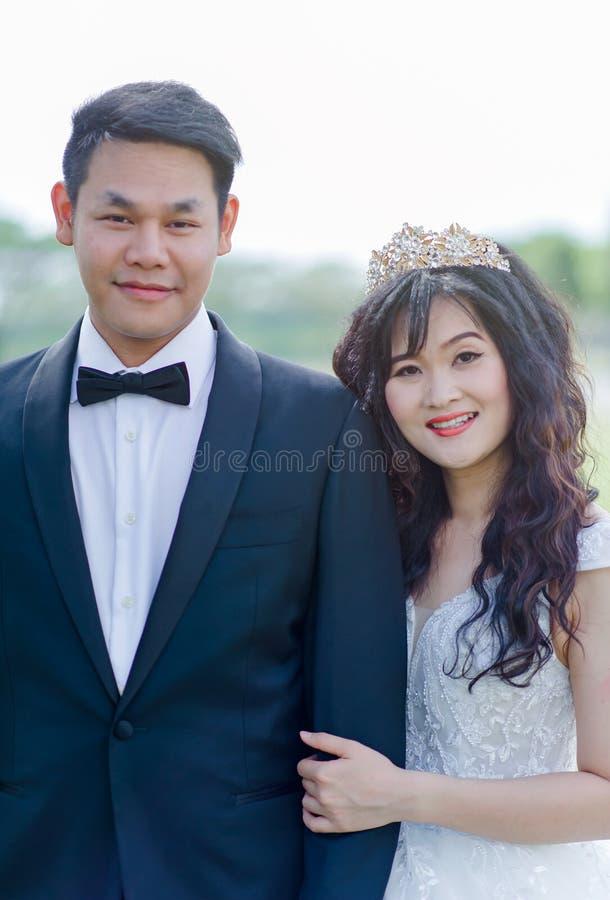 Women's White Floral Wedding Dress and Men's Black 1-button Blazer royalty free stock photos