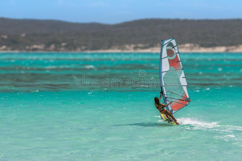 Women& x27;s windsurfer. Surfing in the lagoon, acrobatic, action, active, athletic, bay, beach, coast, dynamic, exotic, extreme, female, float, focus stock photo