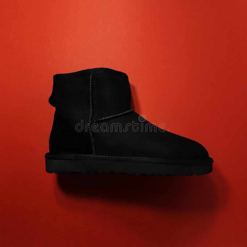 Women`s winter boots. Shoes UGG black royalty free stock images