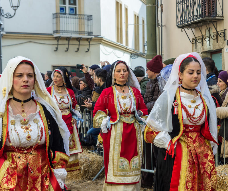 Women in Sardinian costume ride in Oristano during the festival stock image
