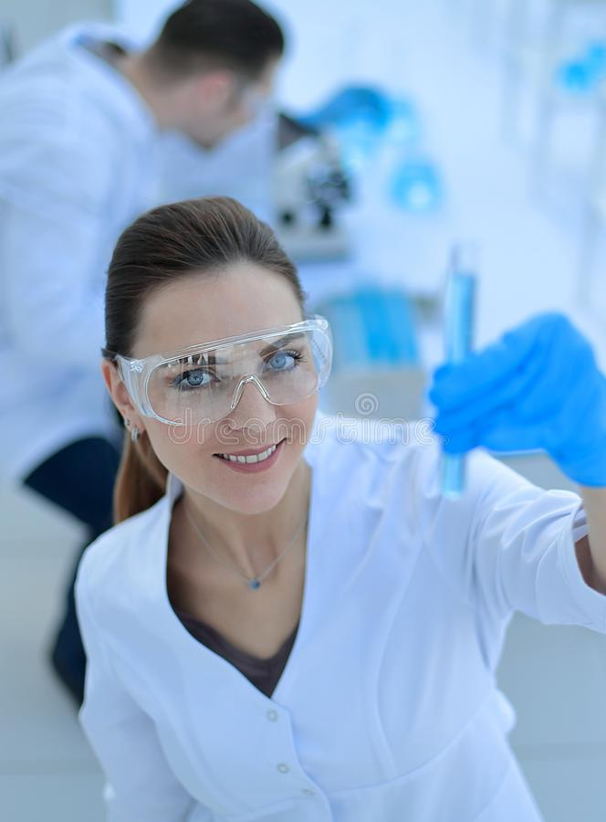 Women scientist with test tube making research in clinical laboratory. Photo with copy space stock photography