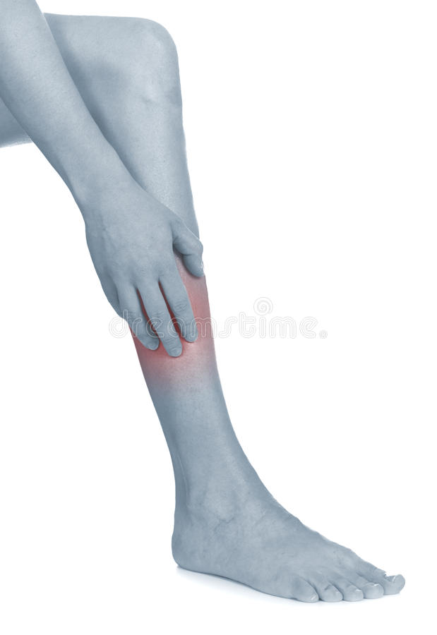 Women scratch itchy leg with hand. royalty free stock photography