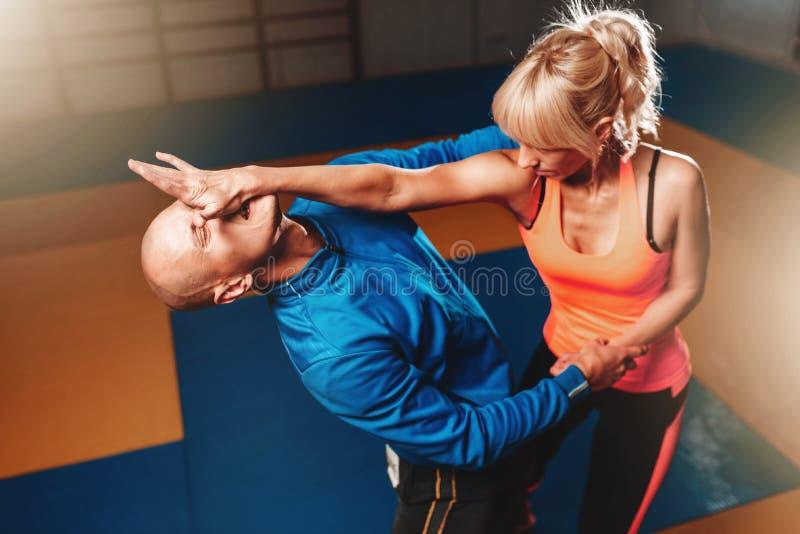 Women self defense technique, martial art. Women self defense technique, workout with personal instructor in gym, martial art stock image