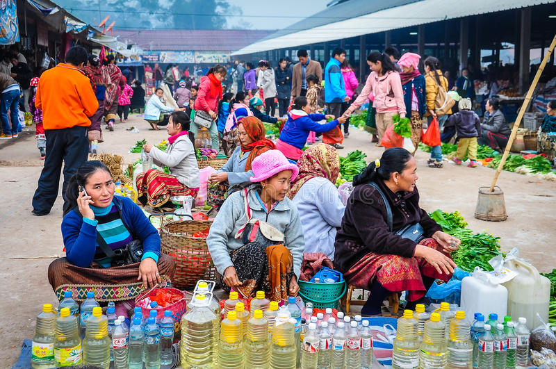 Women selling vegetables in the market, Muang Sing, Laos royalty free stock photography