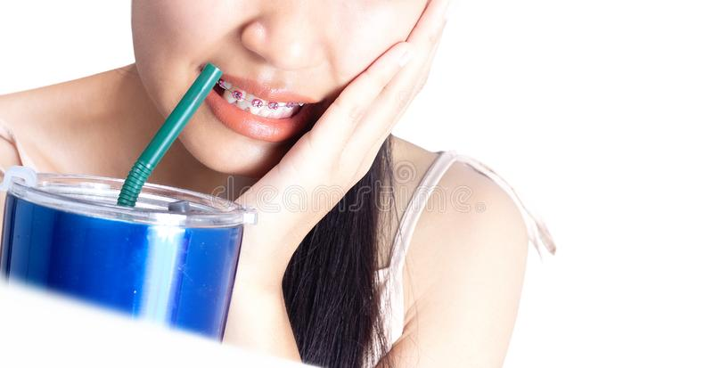 Women are sensitive to teeth because they drink cold stock photo