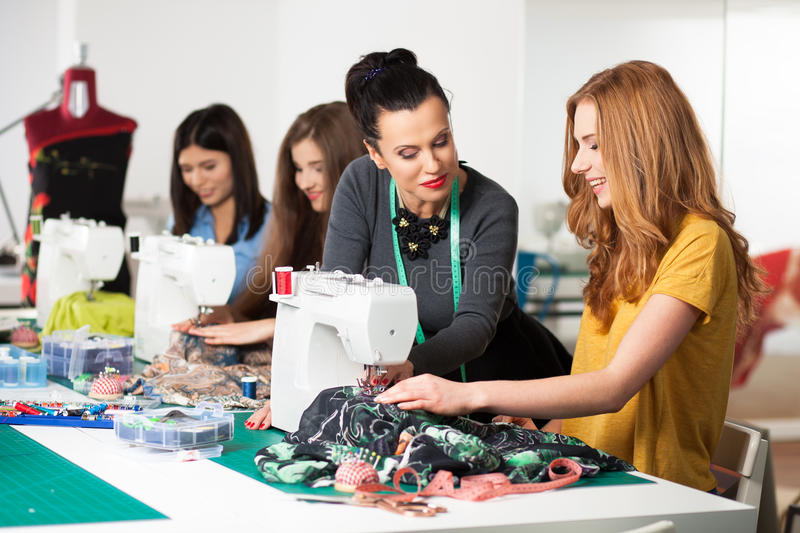 Women in a sewing workshop. Group of women in a sewing workshop stock photos