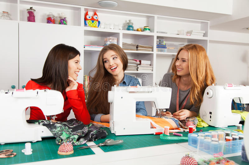 Women in a sewing workshop. Group of women in a sewing workshop stock photography