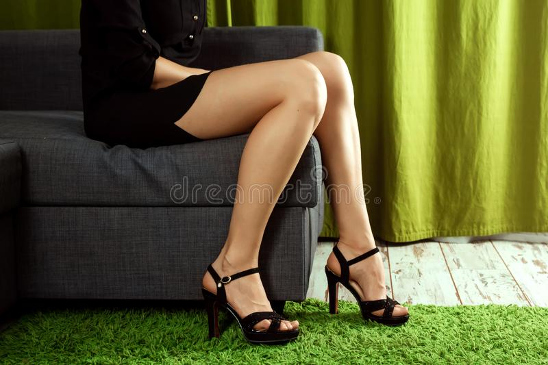 Women sexy legs. Woman legs in high heel shoes. Beautiful woman legs wearing dress with high heels shoes. Concept shoes, women`s. Outfits, the problem of choice royalty free stock image
