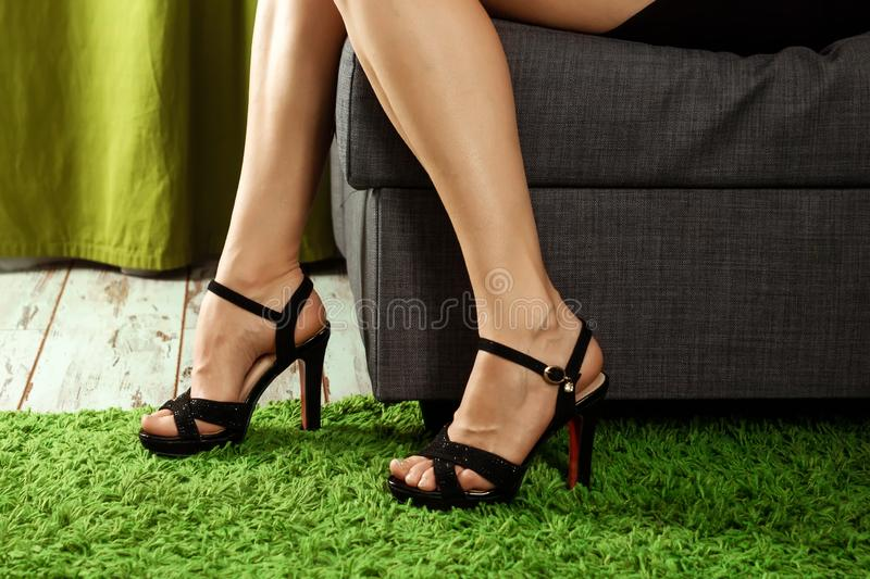 Women sexy legs. Woman legs in high heel shoes. Beautiful woman legs wearing dress with high heels shoes. Concept shoes, women`s. Outfits, the problem of choice royalty free stock images