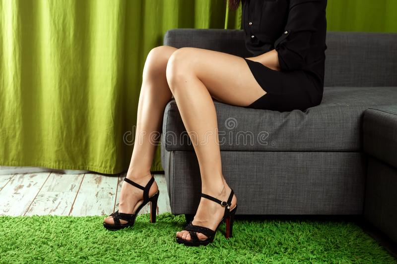 Women sexy legs. Woman legs in high heel shoes. Beautiful woman legs wearing dress with high heels shoes. Concept shoes, women`s. Outfits, the problem of choice royalty free stock photo