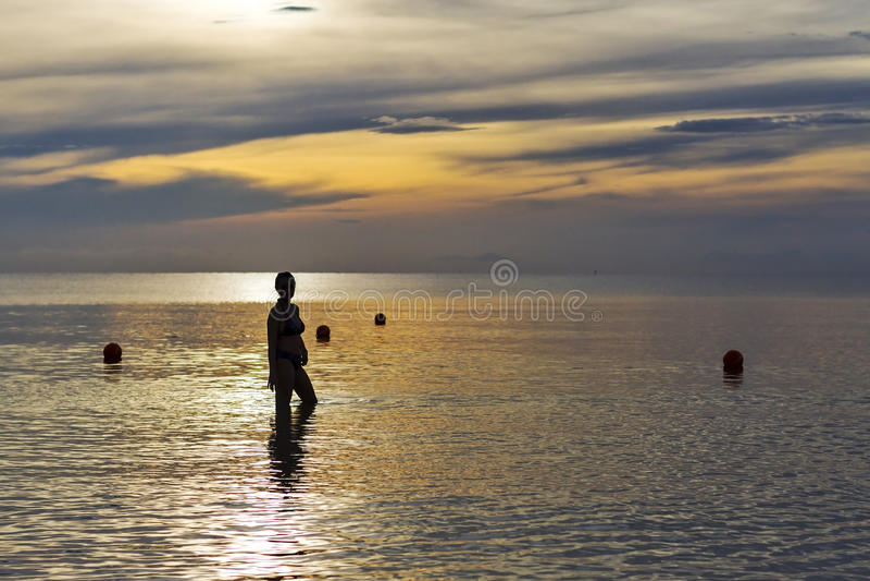 Women shape silhouette sunrise stock photo