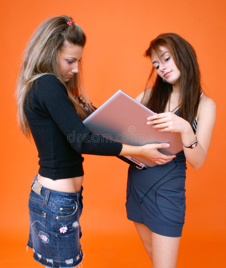 Women sharing a laptop 1 stock photos