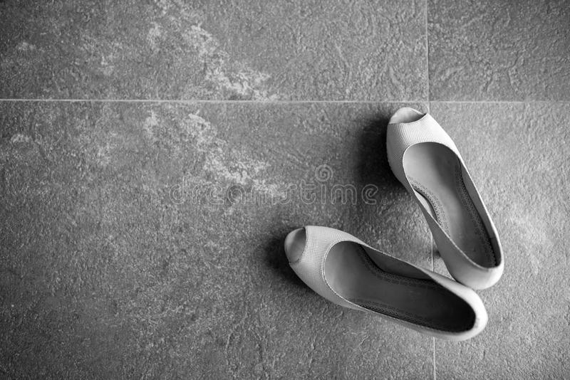 Women shoes on the cement floor. royalty free stock photo