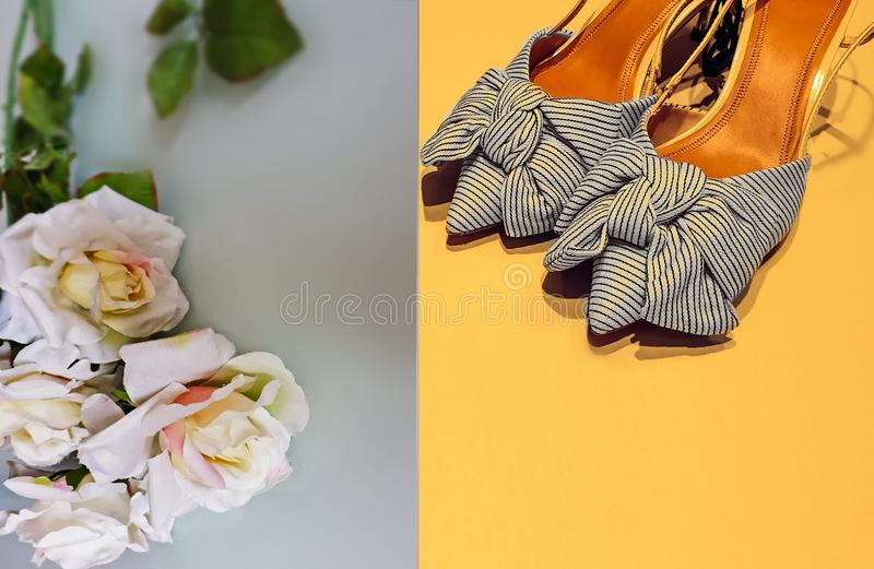 Women shoes  with bow  summer sandals on high heels flowers roses pink tea  background  moda concept luxury elegance glamour  yel royalty free stock photography