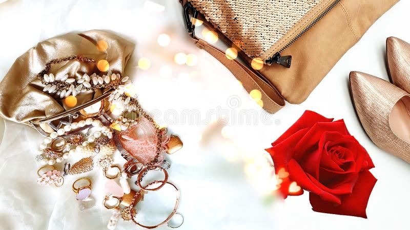 Women shoes and handbag gold stylish elegant luxury accessories roses flowers still life shop girl clothes,Jewelry white pearl fas. Hion scarves handbag bags royalty free stock image