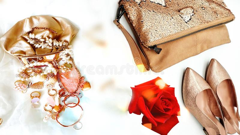 Women shoes and handbag gold stylish elegant luxury accessories roses flowers still life shop girl clothes,Jewelry white pearl fas. Hion scarves handbag bags royalty free stock photography
