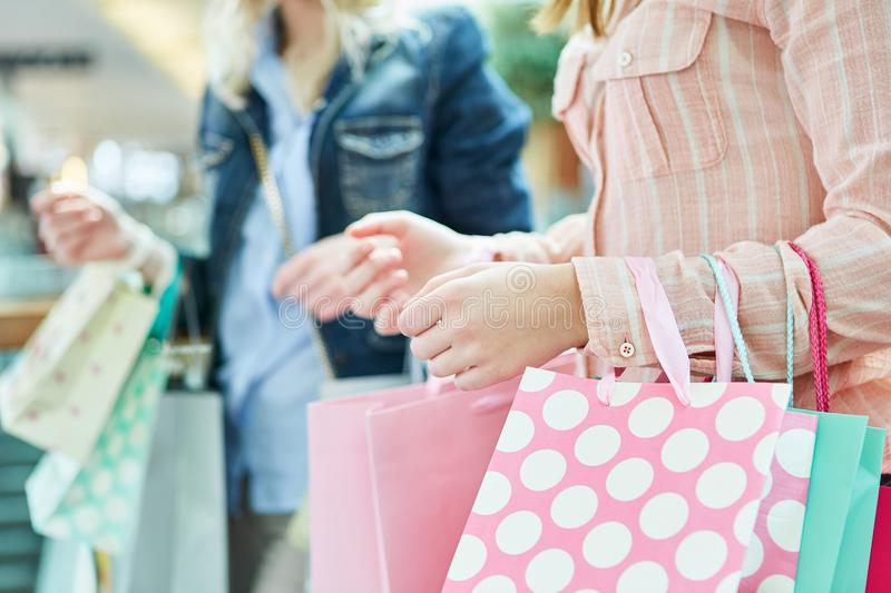 Women with shopping bags while shopping. Women with shopping bags shopping at retail mall royalty free stock photos