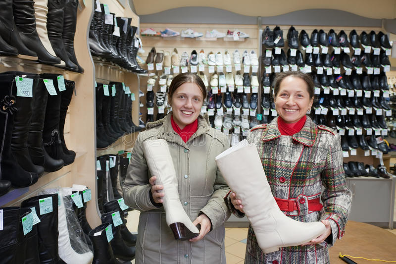 Download Women Shopping Boots At  Shoe Stock Photo - Image: 16521724