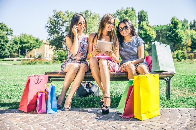 Women shopping and looking at tablet stock photos