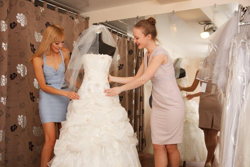 Women Shopping For Wedding Dress royalty free stock photos