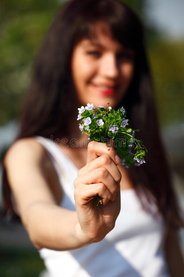 Download Women Show A Bouquet Forget-me-not Stock Image - Image: 19508617